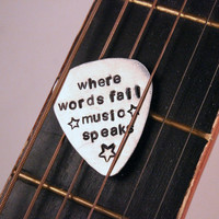 """""""Where words fail, music speaks"""" Hand stamped Guitar Pick"""