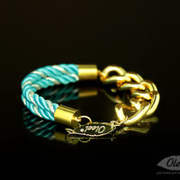 by (Oleel) Silken Silver-Blue Cords Bracelet with Golden Chain