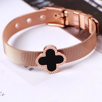 Rome X Cartier exaggerates the big brand titanium steel plated rose gold Roman letter personality four-leaf flower personality simple bracelet bracelet jewelry