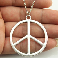 WYSIWYG silver tone 42mm peace sign pendant necklace