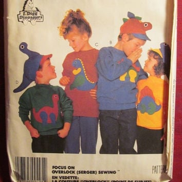 SALE Uncut McCall's Sewing Pattern, 3171! Stretch Knit Tops/Shirts/Sweater/Kids/Children/Dinosaur Appliques/Hats/Oversized/All Sizes/long sl