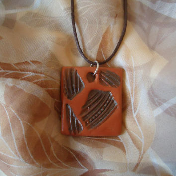 The warm earth. Handmade ceramic pendant. Dark brown and light brown. Natural colors. Square shape.FREE SHIPPING!
