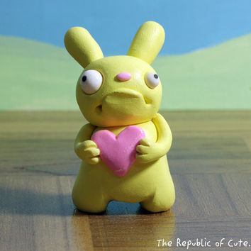 Crazy Yellow Bunny Figurine with Pink Heart - Offbeat Designer Toy for Kids Teens Adults - Fun Desk Accessory - Handmade Original Sculpture