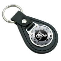 Letter M on Fleur De Lis Pattern Black Leather Keychain