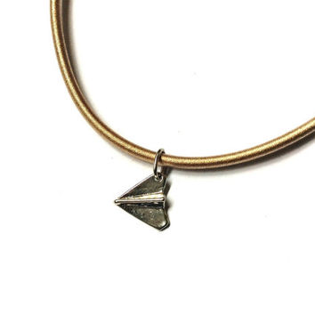 origami paper plane / airplane charm in nude cord necklace