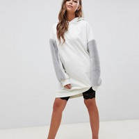 ASOS DESIGN hoodie sweat dress with faux fur sleeves at asos.com