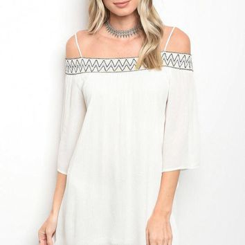 Ladies fashion 3/4 sleeve off the shoulder skater dress that features embroidered details