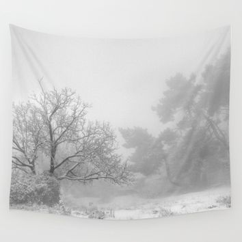 """Into the snowy forest"". Foggy mountains Wall Tapestry by Guido Montañés"