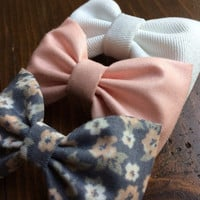 Peach, white denim, and grey and pink floral hair bow set from Seaside Sparrow. These hair bows make a perfect gift for her.