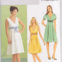 Sewing pattern for  A -line dress with wrap bodice, empire waist, pleated skirt misses size 6 8 10 12 Butterick 5024 UNCUT