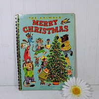 A Big Golden Book in Full Color The Animals' Merry Christmas Book Stories by Kathryn Jackson Pictures by Richard Scarry ©1950 First Edition