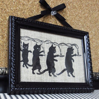 Framed Screen Print of a Black Kitty Cats holding candles over Natural Burlap
