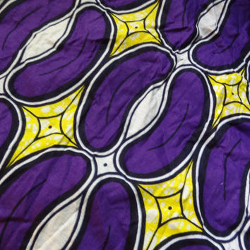 African Wax Print Fabric by the HALF YARD. Pods in purple, yellow, white, and black.