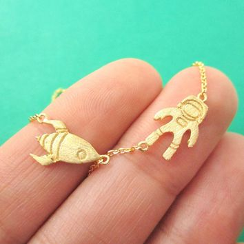 Spaceship and Astronaut Space Travel Themed Charm Necklace in Gold | DOTOLY