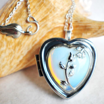 Music box locket, heart shaped locket with music box inside, in silver tone with white opal crystal heart and silver accents.