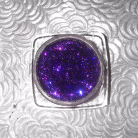 Shade name ( Aurora ). Deep sultry purple loose glitter pigment. 4 grams of product in a jar with sifter and seal.