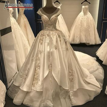 2017 Real Sample Royal Lace Applique Crystal Puffy Ball Gown Long Train Back Wedding Dress
