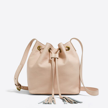Leather bucket bag with tassels