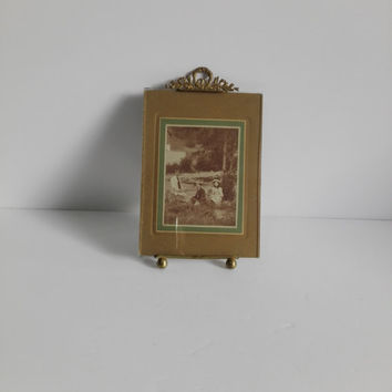 Old french photo frame , Louis XVI style, on brass and glass.