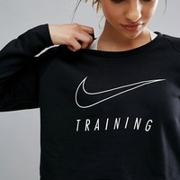 Nike Training Dry Long Sleeve Cropped Top at asos.com