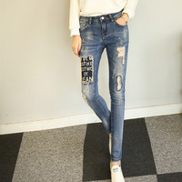 Personality Fashion Letter Patch Irregular Ripped Worn Embroidery Small Foot Pants Long Jeans
