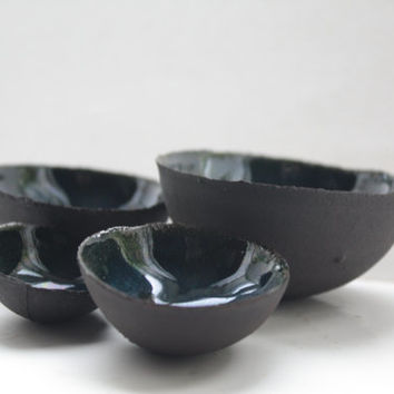 Limited Edition set of 4 chocolate black earthenware nesting bowls with blue interior.