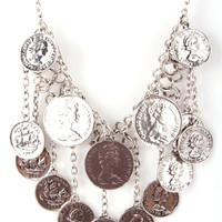 This chain link statement necklace features a bib of dangling coins. Pair with Free People Dresses.