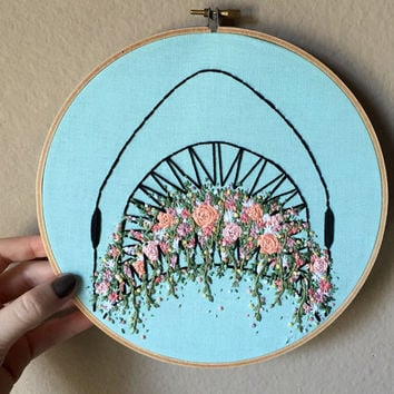 Shark attack hand embroidery with colorful florals coming out of his mouth, set in large 8 inch hoop, embroidered wall art