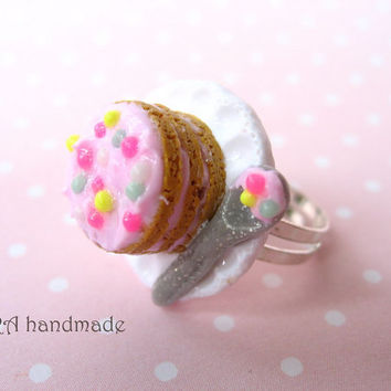 Kawaii cake with a spoon on a plate ring