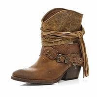 Brown wrapped buckle western boots