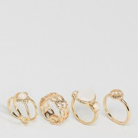 ASOS Pack of 4 Faux Opal Shimmer Stone Rings at asos.com