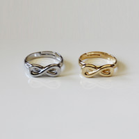 INFINITY STATEMENT FINGER TIP RING