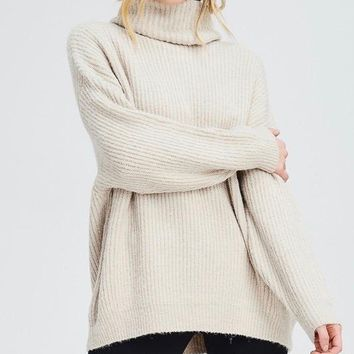 oversized turtle neck knit sweater in beige