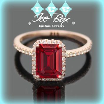 Cultured Pigeon Blood Ruby Engagement Ring 1.5ct Emerald Cut Pigeon Blood Ruby set in a 14k Rose Gold Diamond Halo Setting