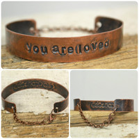 you are loved hand stamped on copper CUFF/bracelet with lobster clasp closure
