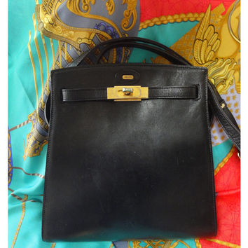 Vintage BALLY genuine black leather kelly ado style shoulder bag purse with gold tone hardware and logo charm.