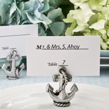 "Nautical Silver Anchor Place Card / Photo Holder. Size Is 2"" Tall X 1 1/2"" Wide Nautical Themed Anchor Place Card / Photo Holder. Crafted From Poly Resin in a Silver Pewter Finish. Anchor Stands on Twisted Rope That Winds Upwards to the Top. Slit on Top Al"
