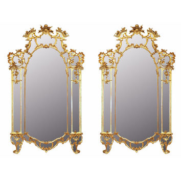 A pair of mid 18th century, circa. 1740, Tuscan giltwood mirrors