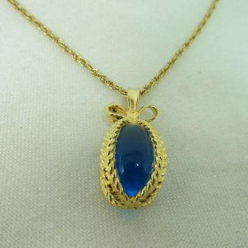 JOAN RIVERS Blue Glass Egg Necklace