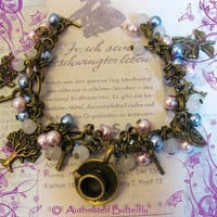 Alice in wonderland beaded charm bracelet