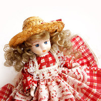 Vintage Porcelain  Doll with Red Lace Dress and Hat .