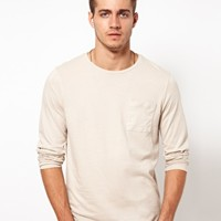 ASOS Long Sleeve Crew Neck T-Shirt With Pocket at asos.com