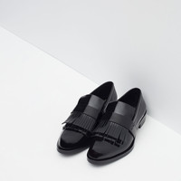 FRINGED PENNY LOAFERS New