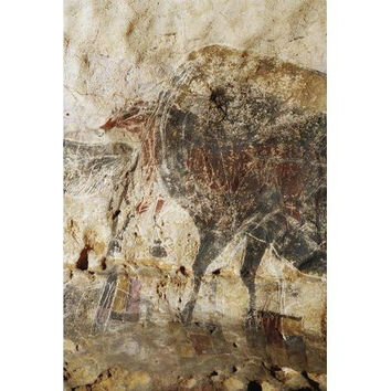 Prehistoric artists carved images over cave paintings of animals