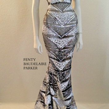 The Fenty Baudelaire Parker Titanium Gown, Sequins, Tinsel, Micro Fiber Embroidery on mesh/net. Pattern Embroidery on hem of gown