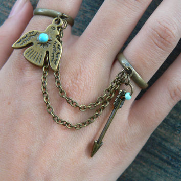 thunderbird and arrow double ring in brass chained slave ring tribal inspired