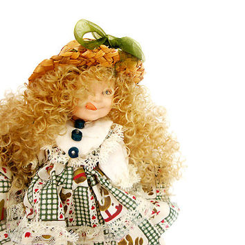 Vintage Porcelain Doll  blonde with long curly hair .