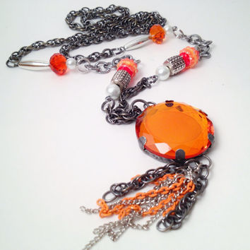 Orange pendant with gunmetal chain and tassel necklace