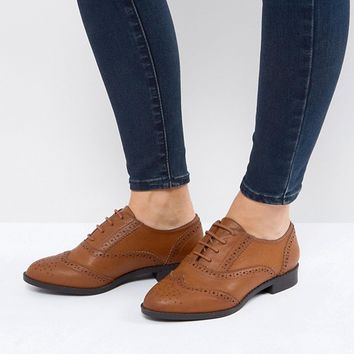 ASOS MANIC Wide Fit Flat Brogues in Water Based PU at asos.com