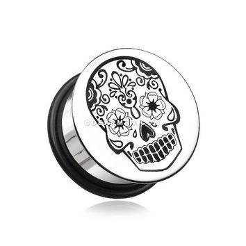 A Pair of Single Flared Steel Day of the Dead Sugar Skull Flat Top Hollow Plug